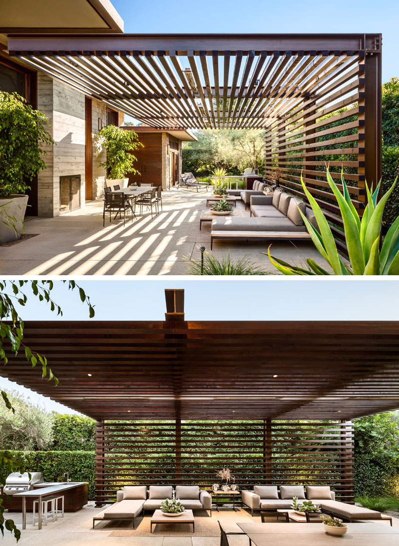 This outdoor living space makes the most of the louvre roof and wall to create a super comfortable space
