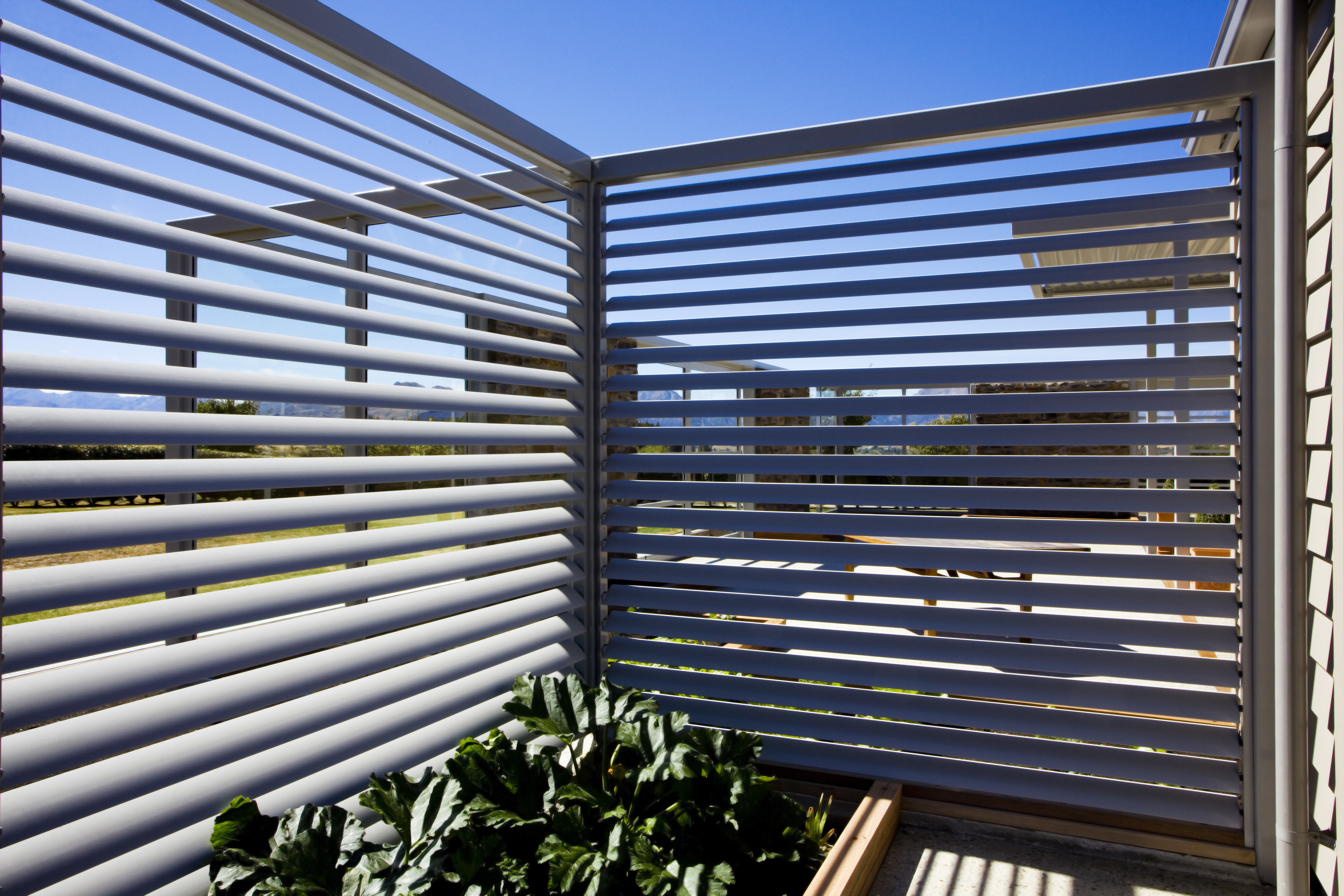 Manually operable louvres from Aurae