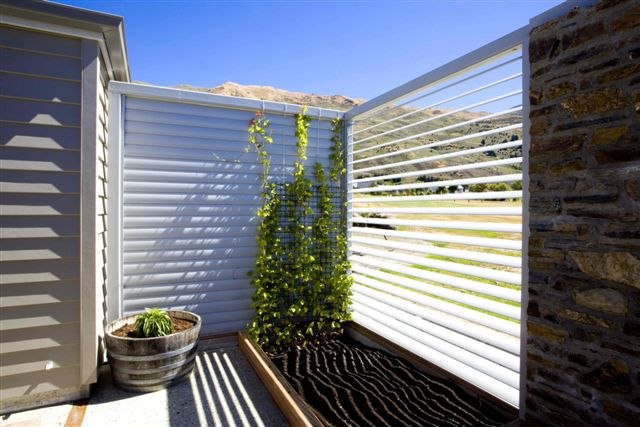 Manually operable louvres