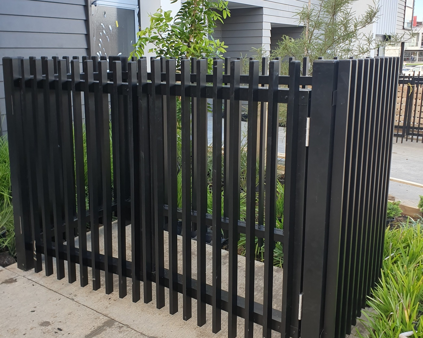 Bin screen with black powder-coated louvre blades
