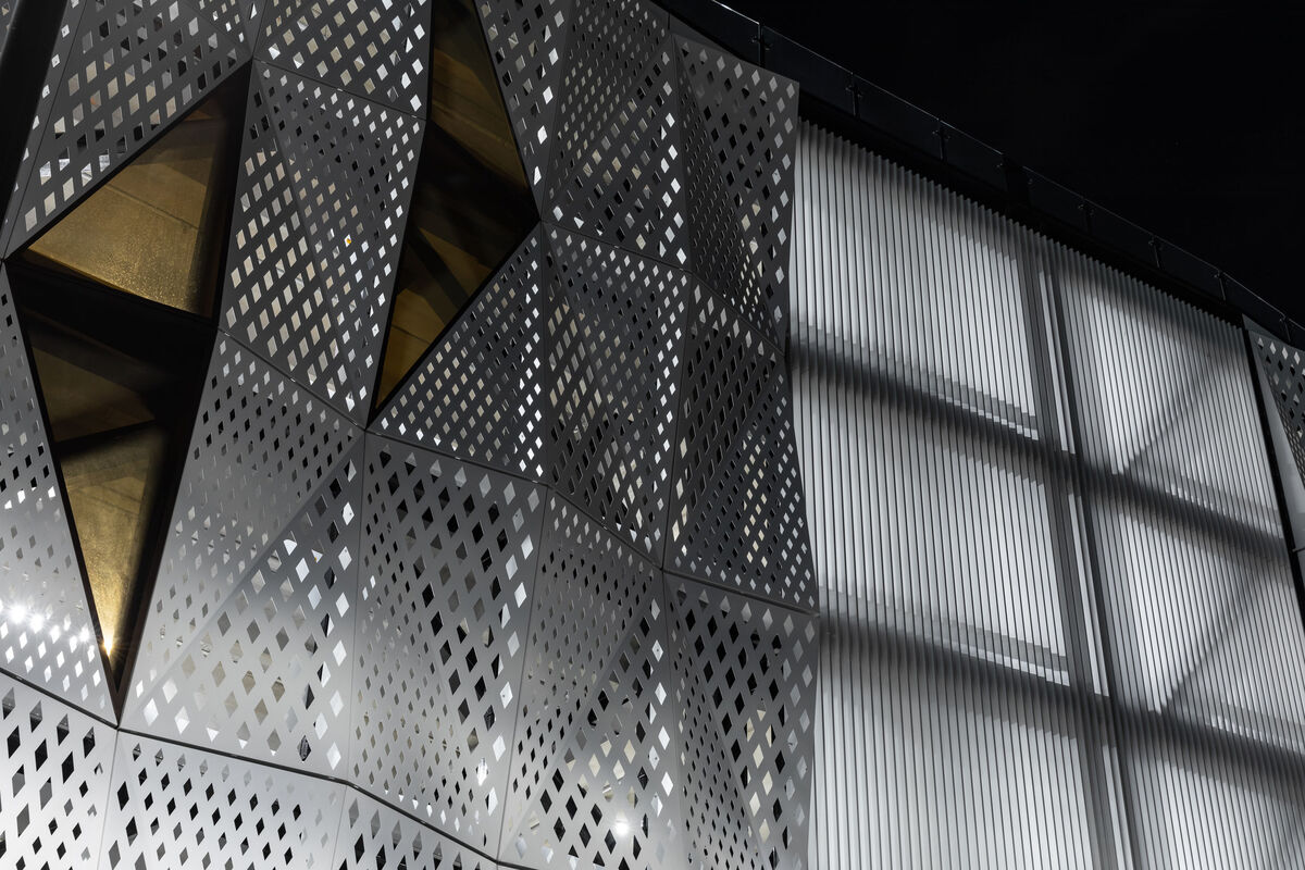 Perforated building facade screen